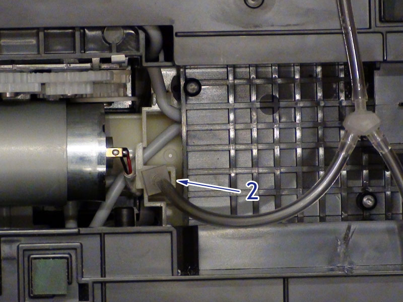 Insert smaller connector (2) into overflow waste tube