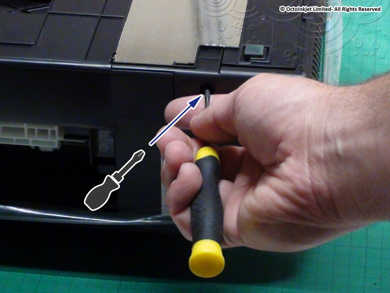 Use Phillips screwdriver to release screw indicated