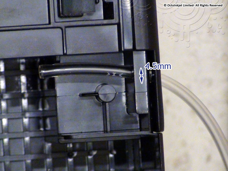 Disconnect the main tube from the Y-fitting and thread through enlarged screw hole